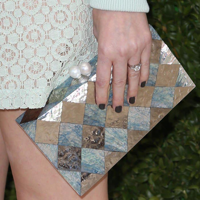 Kate shows off her engagement ring and Emm Kuo silver and turquoise clutch