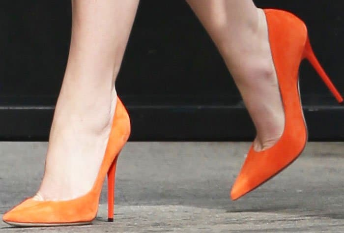 Katherine Heigl adds a pop of orange into her look with a pair of Christian Louboutin So Kate pumps