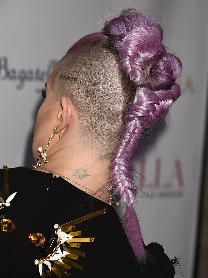 Kelly Osbourne rocking a purple braided mohawk with shaved sides.