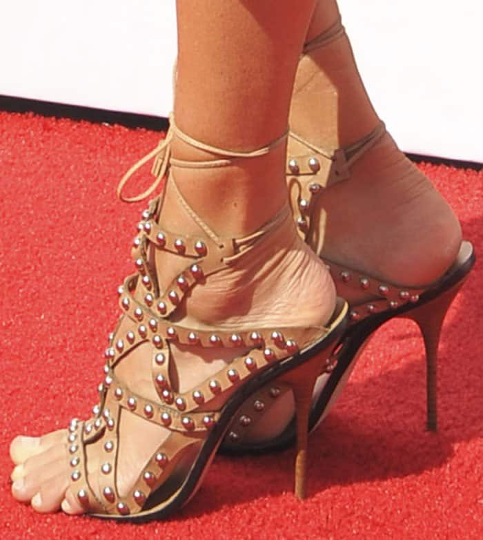 "Kelly wears a studded pair of Sophia Webster ""Mila"" sandals in tan leather"
