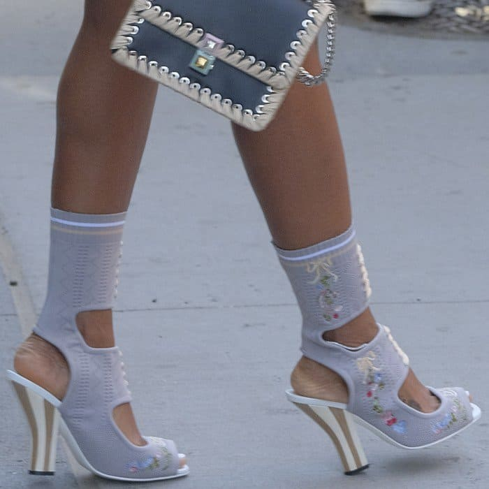 Kelly Rowland wearing stretch-knit ankle sock boots from Fendi