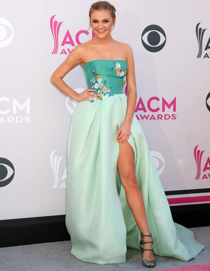 Kelsea Ballerini shows some leg in a strapless gown