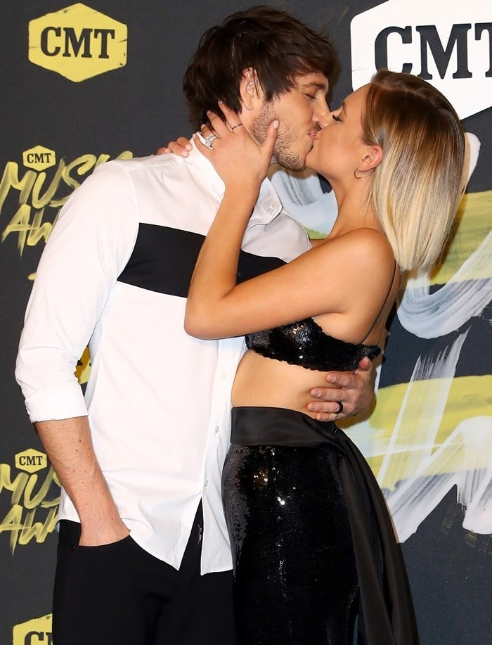 Kelsea Ballerini kisses her husband Morgan Evans on the 2018 CMT Music Awards red carpet