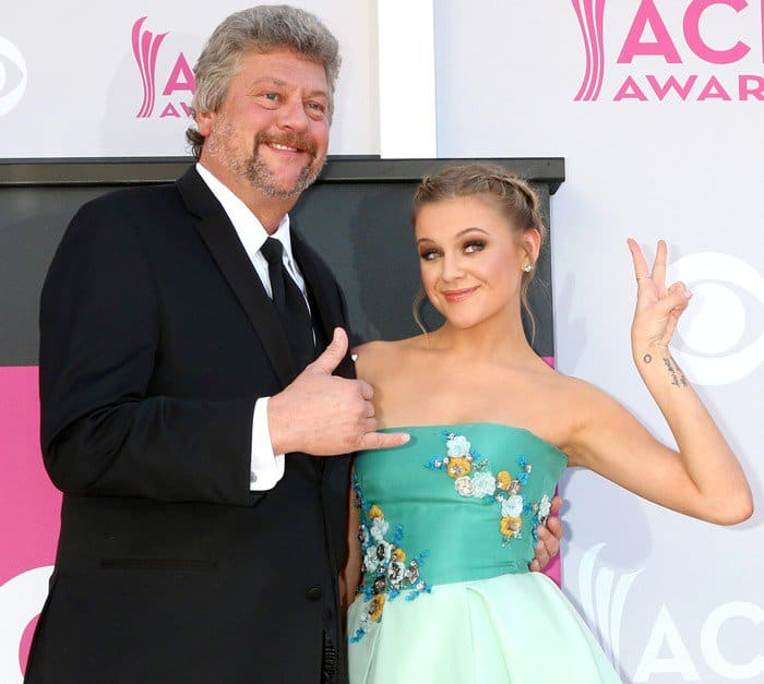 Kelsea Ballerini posing with her father Ed, a former sales manager for a country radio station