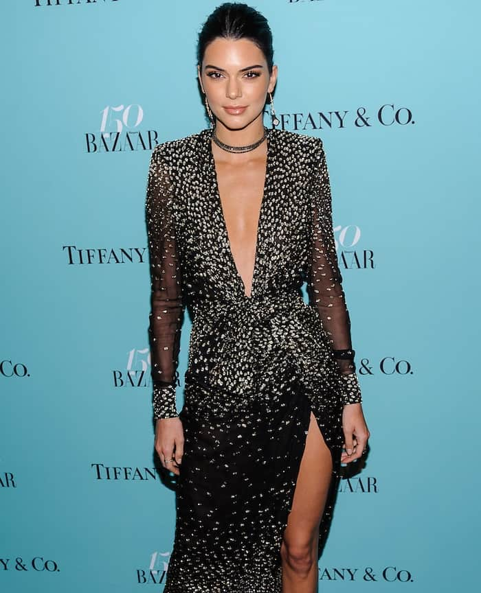 Kendall Jenner's black and gold creation flaunted her long legs and bared her sun-kissed chest