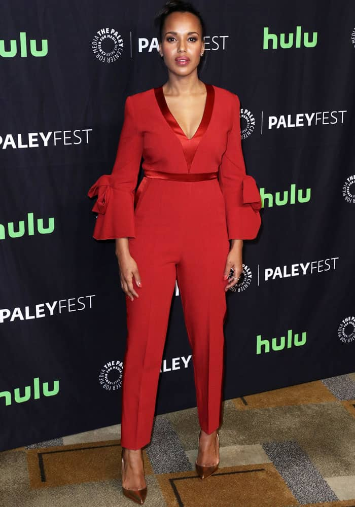 Kerry suits up in a red jumpsuit by Roksanda Ilincic