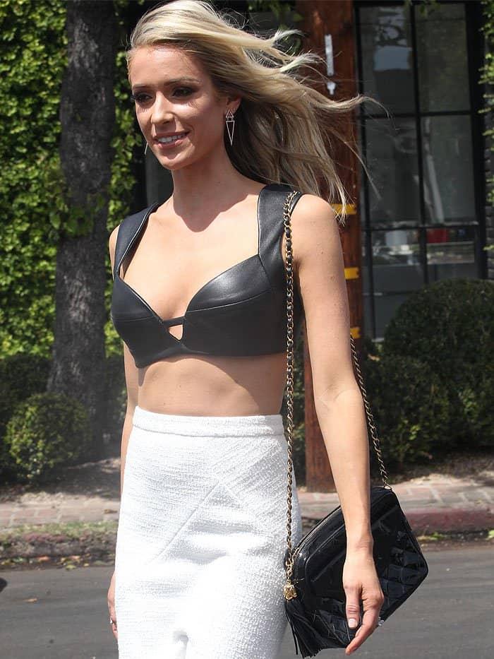 Kristin Cavallariin aRubin Singer black leather bra and a Rebecca Vallance white maxiskirt