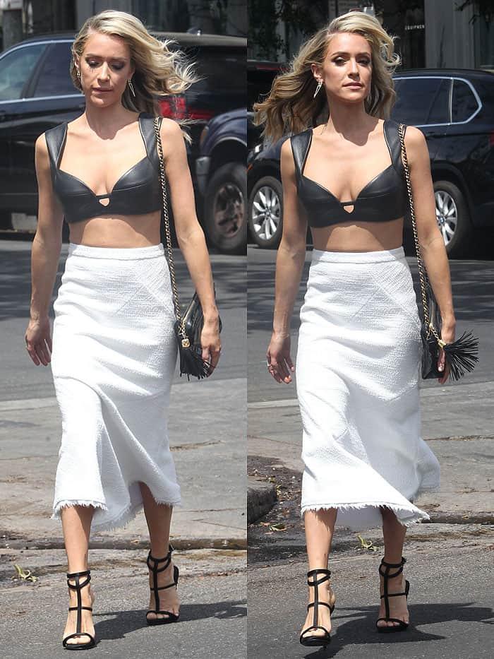 "Kristin Cavallari wearing a black leather bra, frayed white skirt, and Giuseppe Zanotti ""Anne"" sandals"