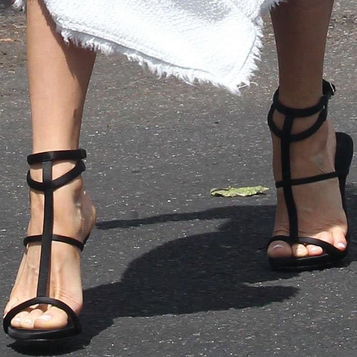 Kristin Cavallari's pinky toes trying toe escape from the straps of her Giuseppe Zanotti Anne sandals
