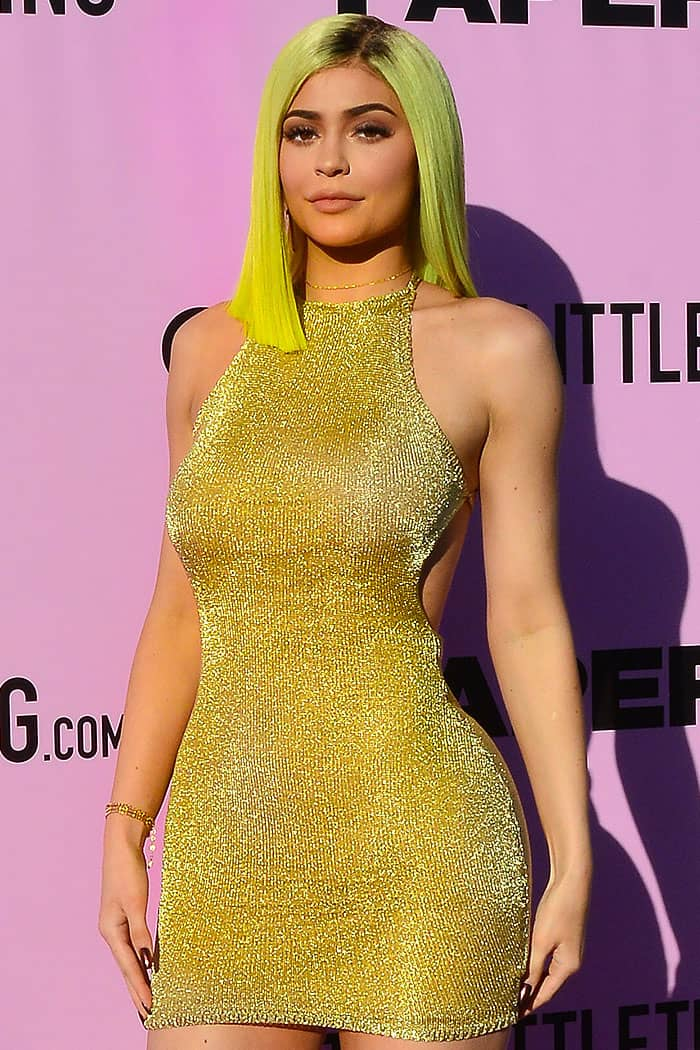 "Kylie Jenner wearing a gold PrettyLittleThing ""Charlay"" knit dress"