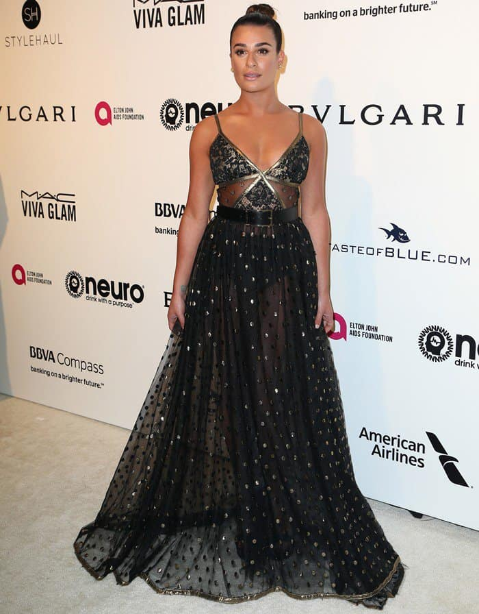 Lea Michele wowed at the Elton John AIDS Foundation's Oscar Party in a sultry gown from the Elie Saab Spring 2017 collection, David Yuman jewelry, and Stuart Weitzman 'SoHot' sandals