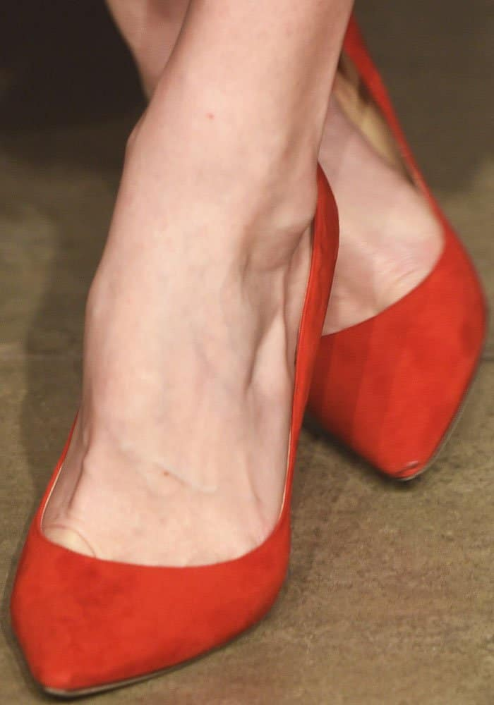 """Liv echoes her gorgeous dress with a pair of bright-hued Jimmy Choo """"Romy"""" pumps"""