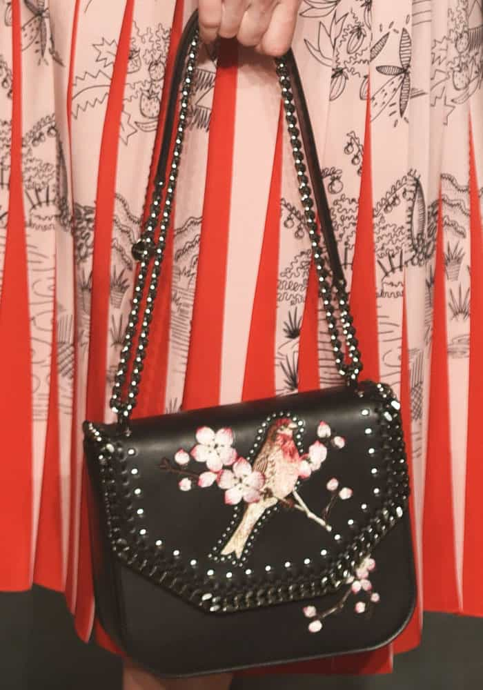 """Liv accessorized with a gorgeous bird-print """"Falabella"""" bag from Stella McCartney"""