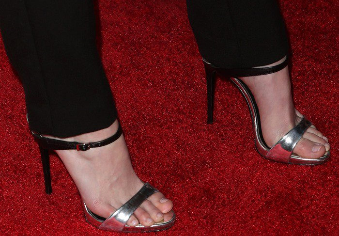 Lydia Hearst wearing silver and black 'Tania' mules from Giuseppe Zanotti