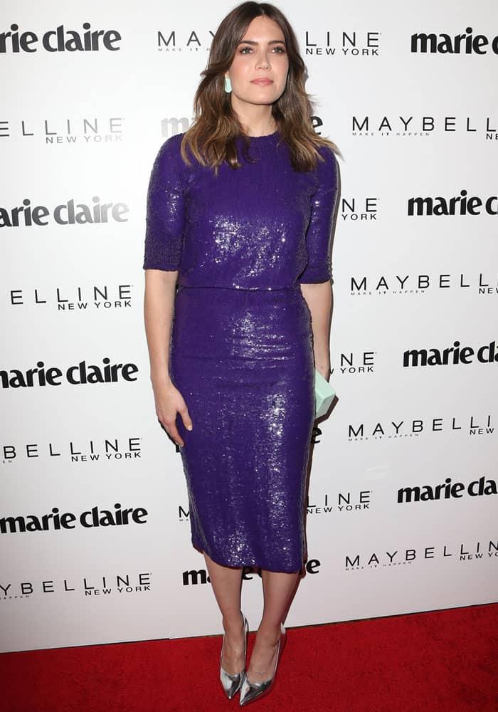 Mandy tries a purple sequined look by designer Jeffrey Dodd