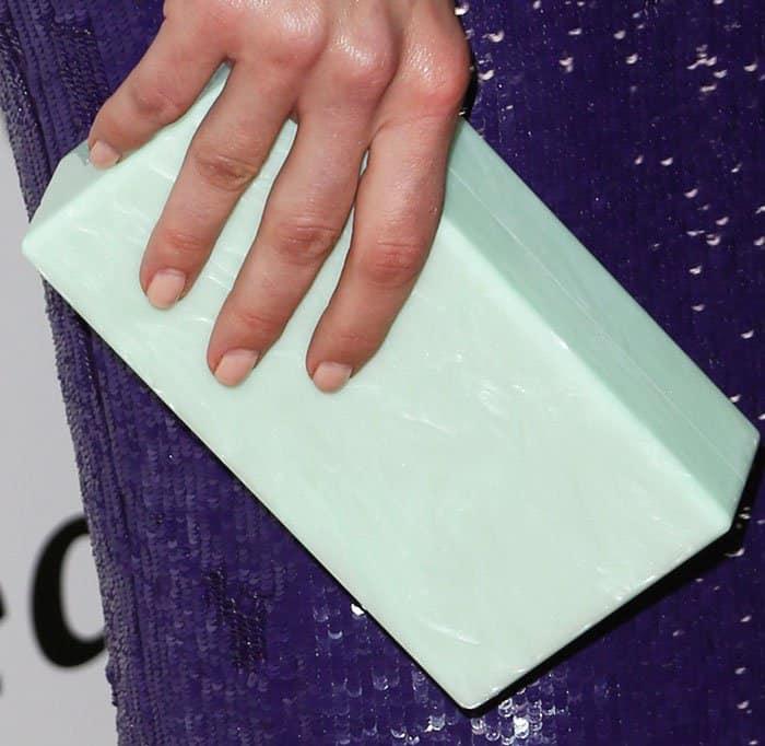 Mandy breaks the purple Jeffrey Dodd dress with a mint clutch by Edie Parker