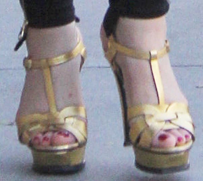 """Mariah carried out her mom duties in a pair of gold Saint Laurent """"Tribute"""" platform sandals"""