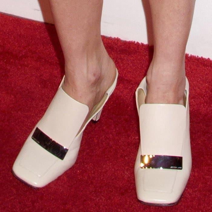 Naomi Watts wearing square toe Sergio Rossi loafers