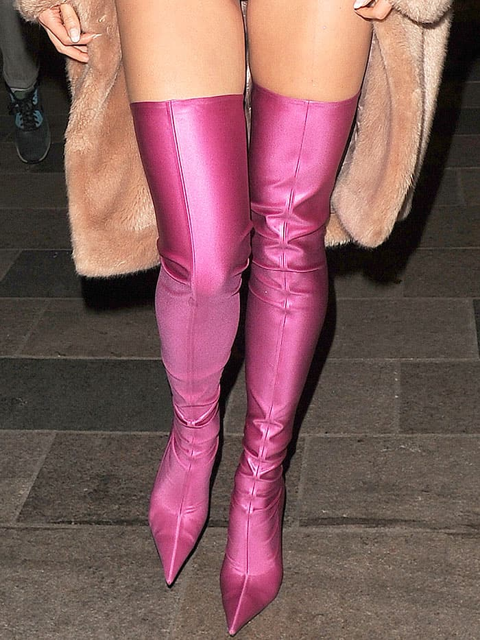 """Pixie Lott wearing a pink superhero-inspired outfit with pink Balenciaga spandex thigh-high boots for a secret gig as part of the """"Sink The Pink"""" club night at The Clapham Grand in London, England, on April 14, 2017."""