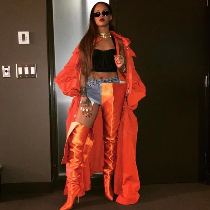 Rihanna showed off a hint of skin as she folded down one leg of her boots