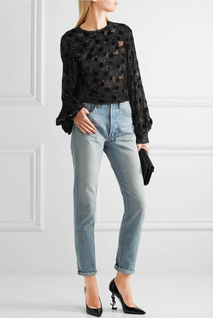 Model wearing Saint Laurent's black patent calfskin 'Opium' pumps with a metallic devoré chiffon blouse and high-rise straight-leg jeans