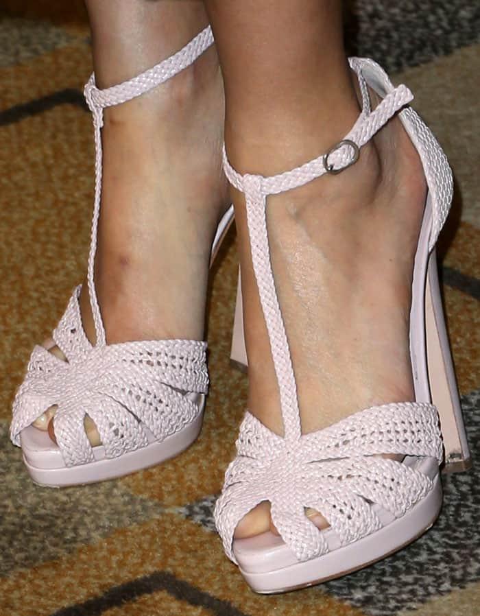 Thandie pairs her Erdem look with Alexander McQueen braided sandals
