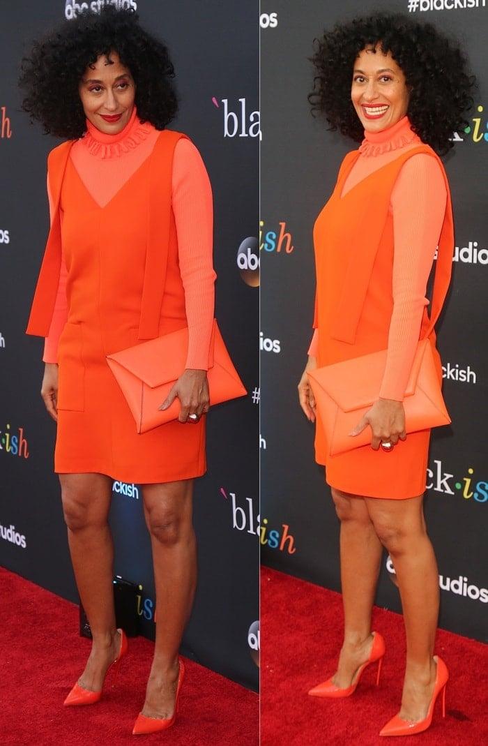 Tracee Ellis Ross in a bright orange dress