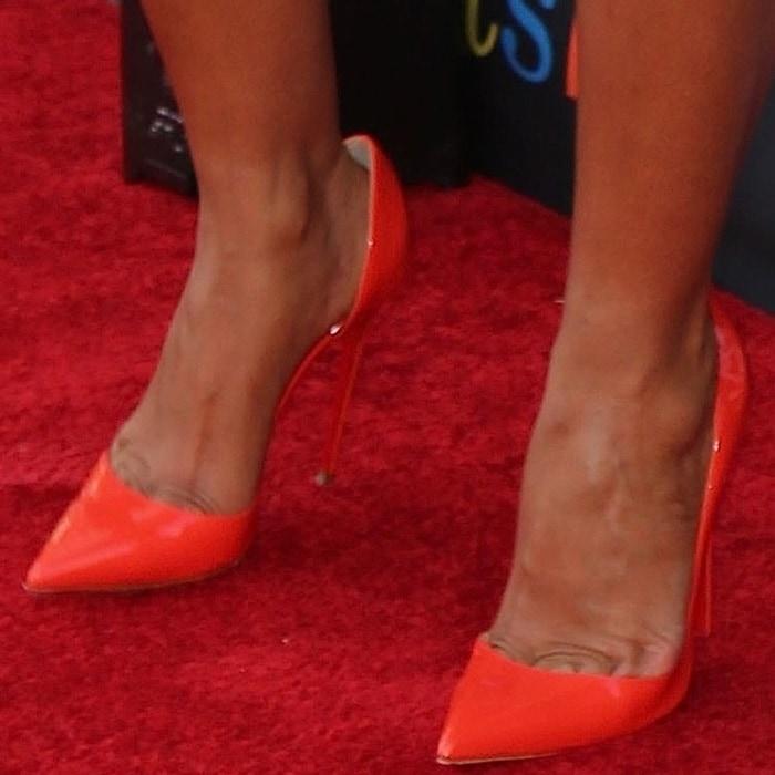 "Tracee Ellis Ross' toe cleavage in orange Christian Louboutin ""Iriza"" pumps"