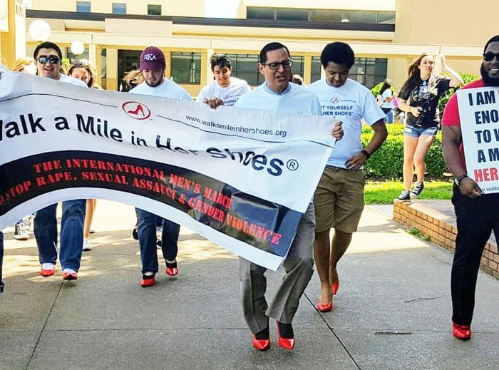 Students and faculty members of Lamar University march a mile together to support the cause