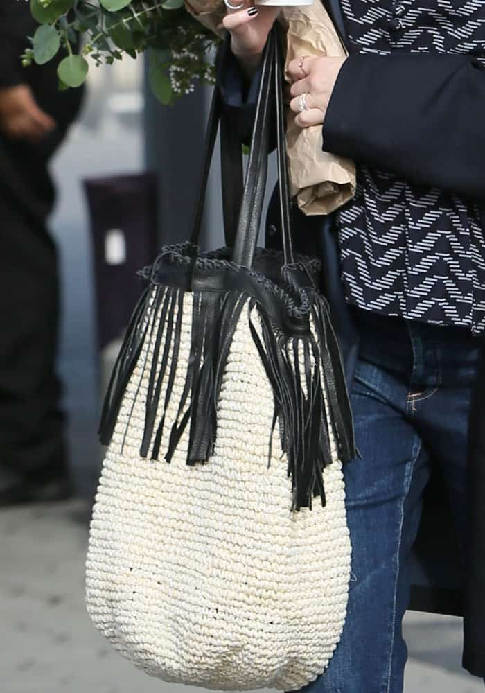 Whitney adds a statement fringed bag to her casual look