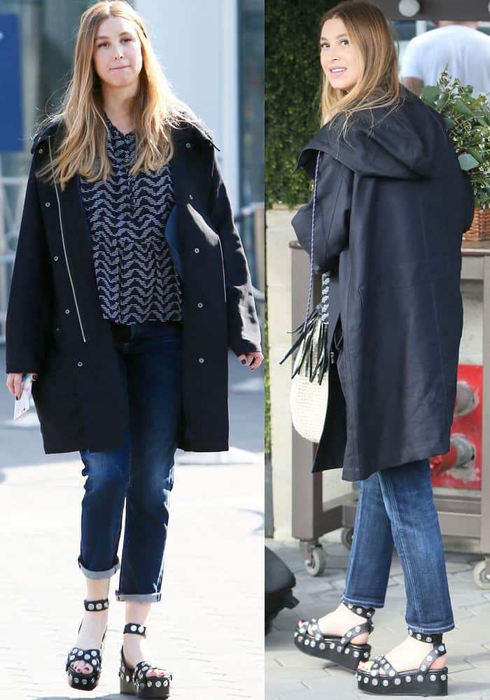 The mom-to-be fends off the cold in a long black hooded jacket