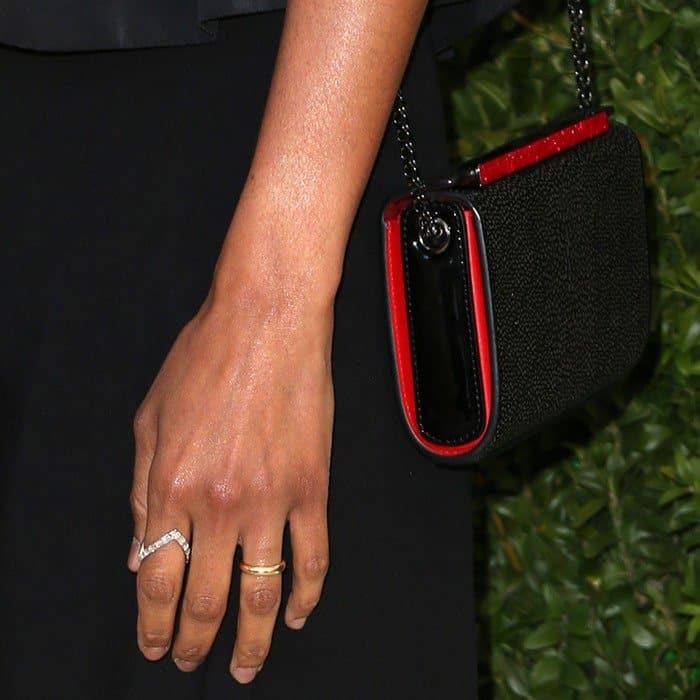 Zoe carrying Christian Louboutin's 'Vanite' clutch
