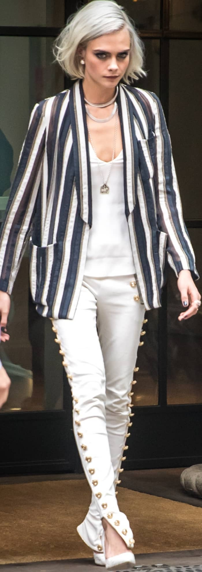 Cara Delevingne wearing a Brunello Cucinelli blazer, J Brand tank, Redemption skinny jeans, and Olgana Paris pumps in NYC