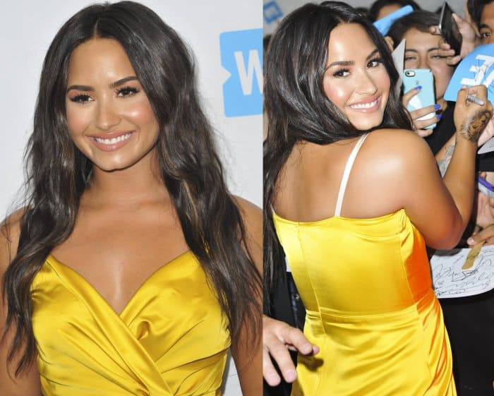 Demi Lovato wearing a Victoria Beckham faux-wrap midi dress