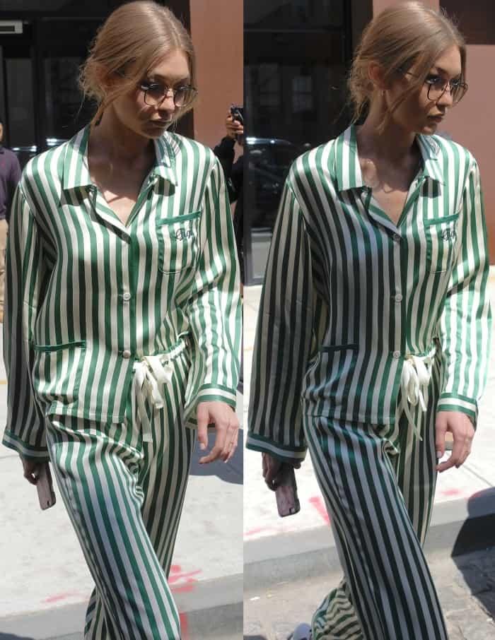 "Gigi Hadid wearing a Morgan Lane emerald silk pajama set and Stuart Weitzman ""Nudistsong"" sandals in NYC"