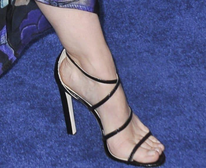 Kristen Stewart wearingblack strappy sandals from Jimmy Choo