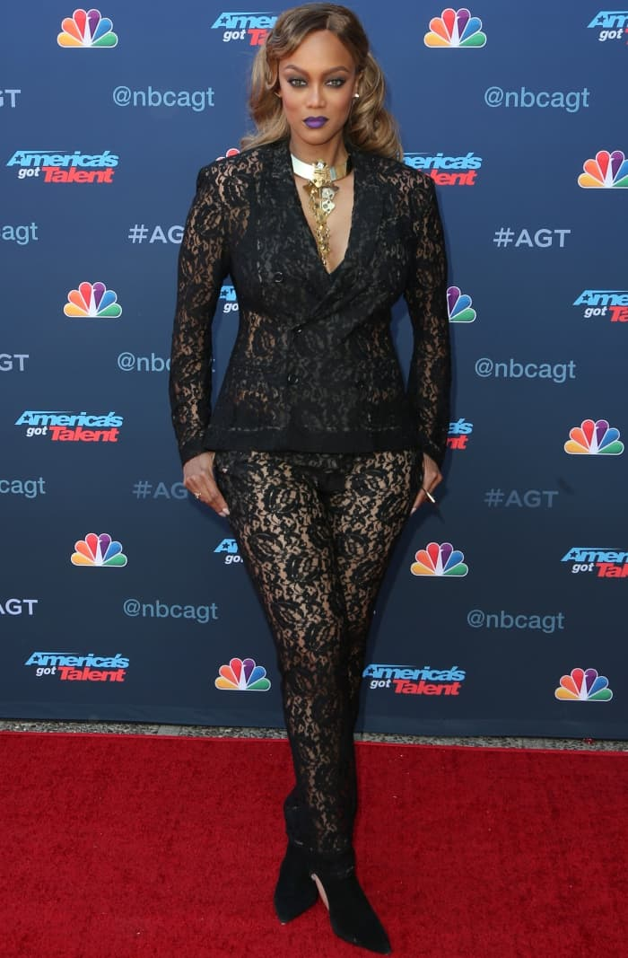"""Tyra Banks wearing a sheer black lace ensemble with black booties at the """"America's Got Talent"""" Season 12 Kickoff"""
