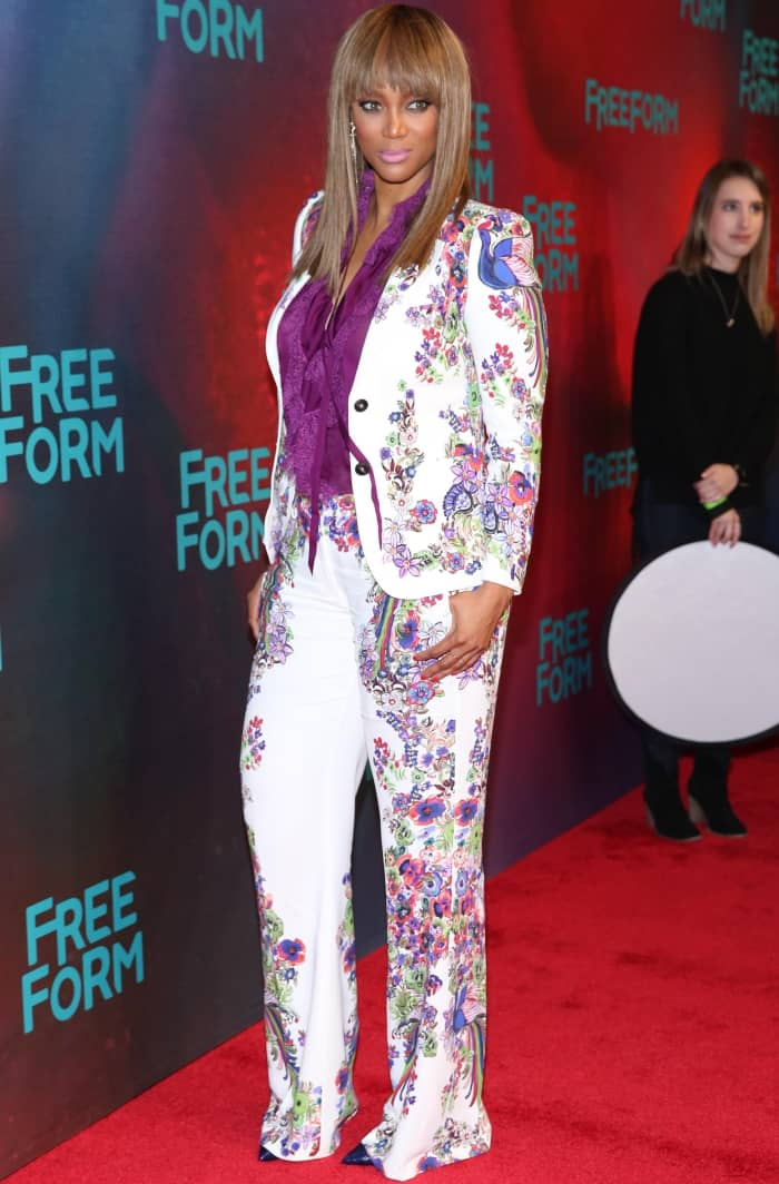 Tyra Banks wearing a Roberto Cavalli resort 2017 ensemble with pointy-toe pumps at the Freeform 2017 Upfront