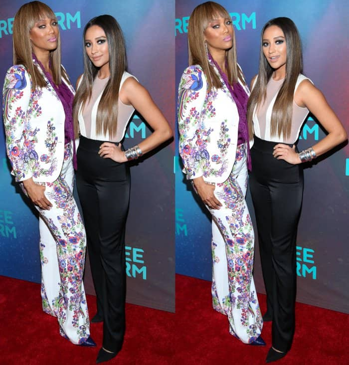 Tyra Banks wearing a Roberto Cavalli resort 2017 ensemble with pointy-toe pumps and Shay Mitchell wearing a Galvan pre-fall 2017 jumpsuit with pointy-toe pumps at the Freeform 2017 Upfront