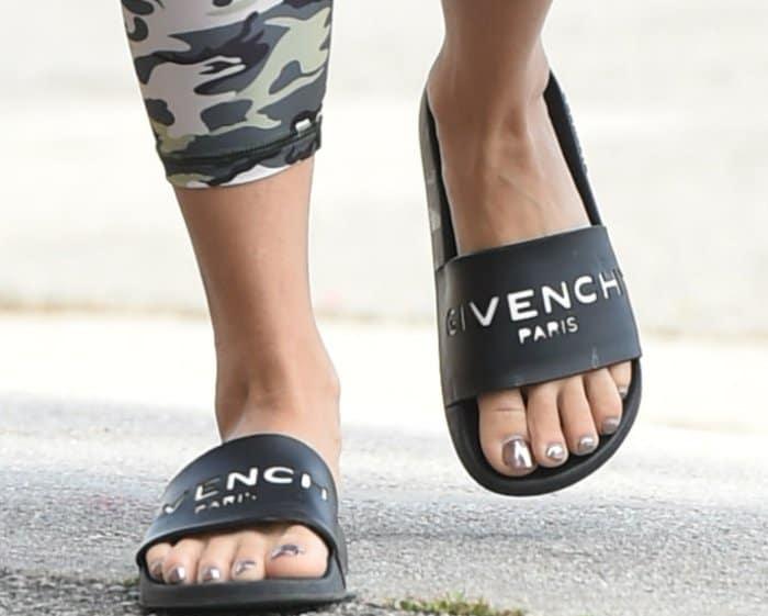 Vanessa Hudgens wearing Givenchy rubber slides