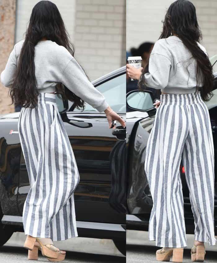 Vanessa Hudgens wearing a cropped Guess Originals sweatshirt, Misa Bazaar pants, and Prada platform mule sandals