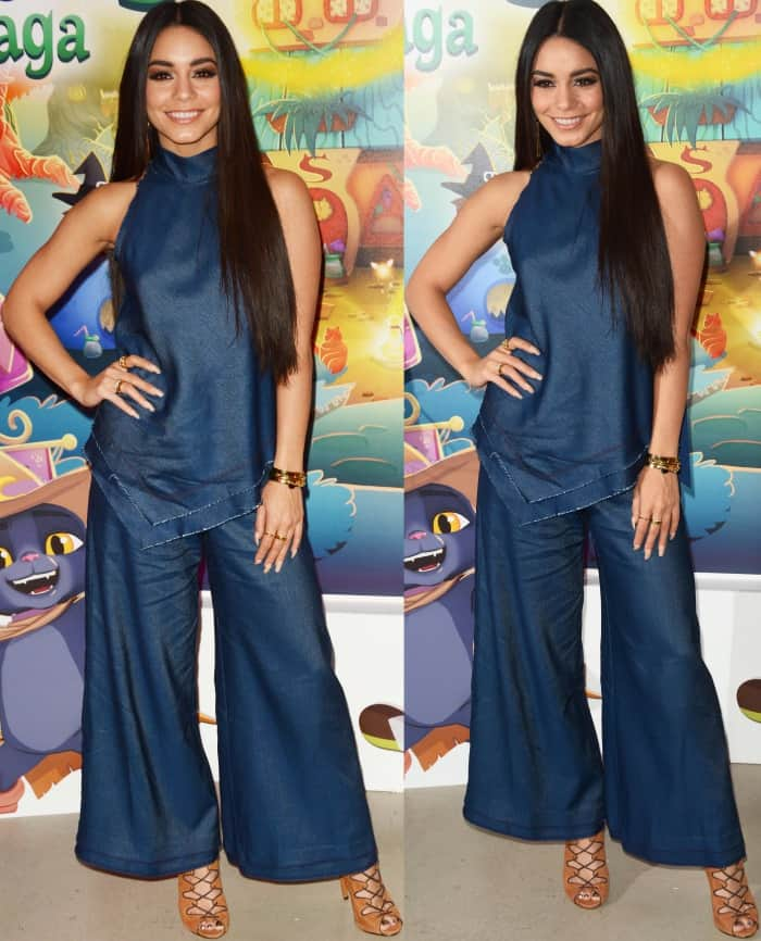 Vanessa Hudgens wearing a dark blue top, matching Manning Cartell pants, and Schutz lace-up sandals