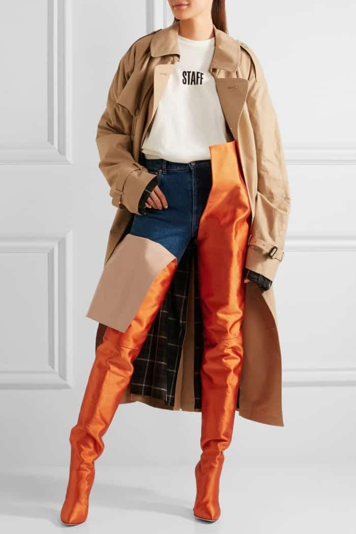 Model wearing Vetements x Manolo Blahnik Waist-High Boots in Bright Orange Satin