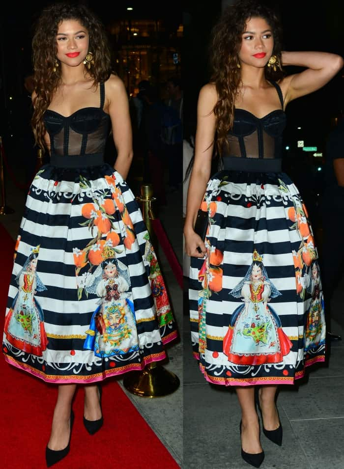 Zendayaexuded youthful charm and sensual eleganceina racy sheer black bustier top tucked into a striped tea-length skirt