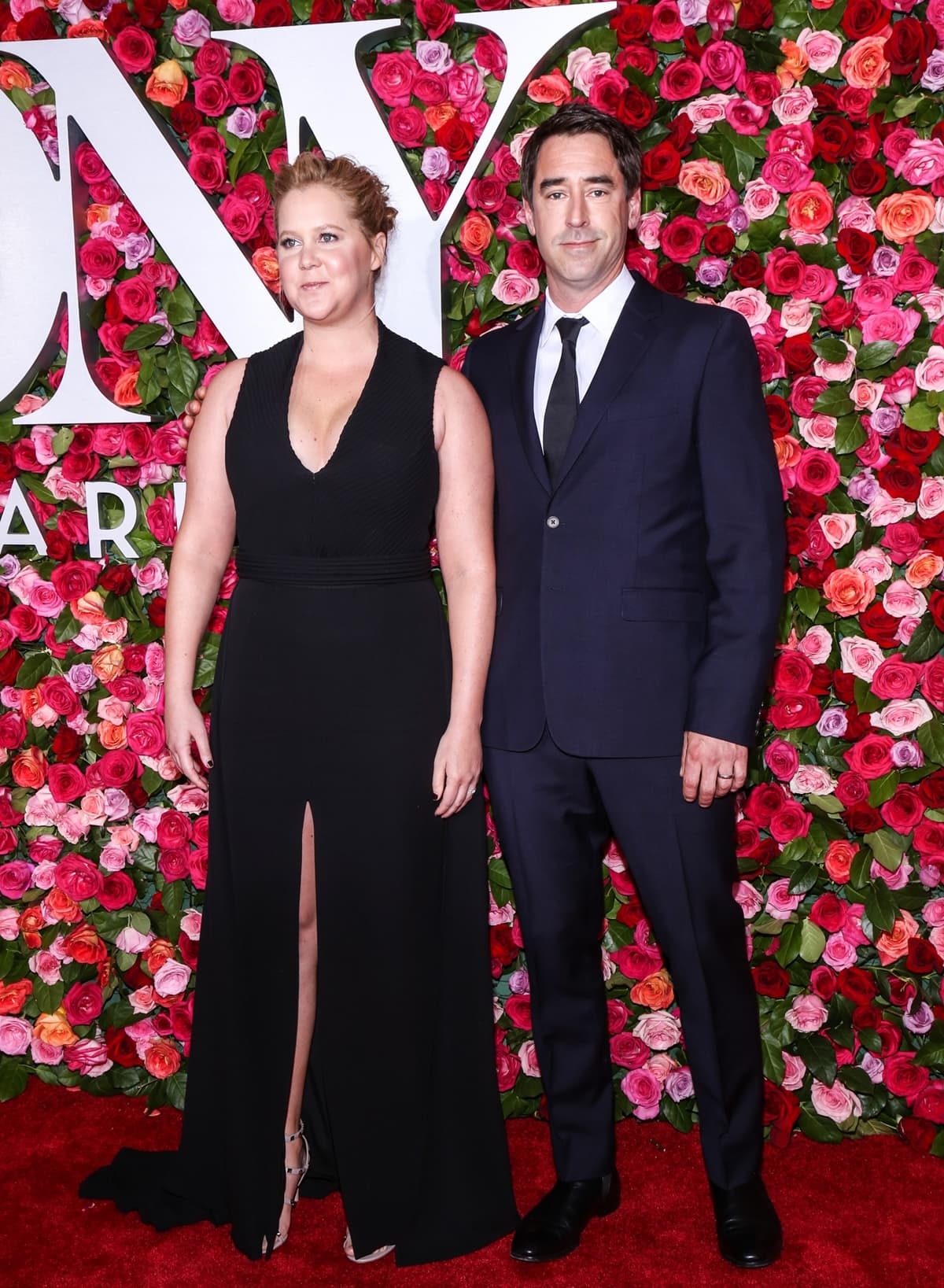 Amy Schumer joined her taller husband Chris Fischer on the red carpet