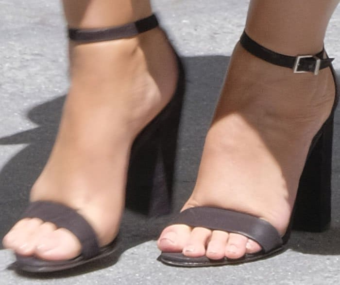 "Ashley plays it safe with a classic pair of Schutz ""Enida"" sandals"