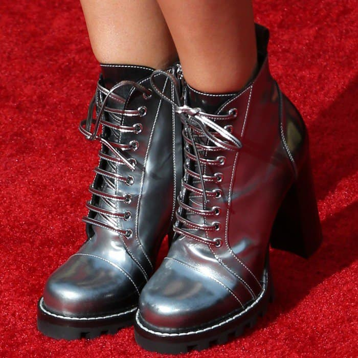 Ashley Tisdale wearing 'Star Trail' ankle boots from Louis Vuitton