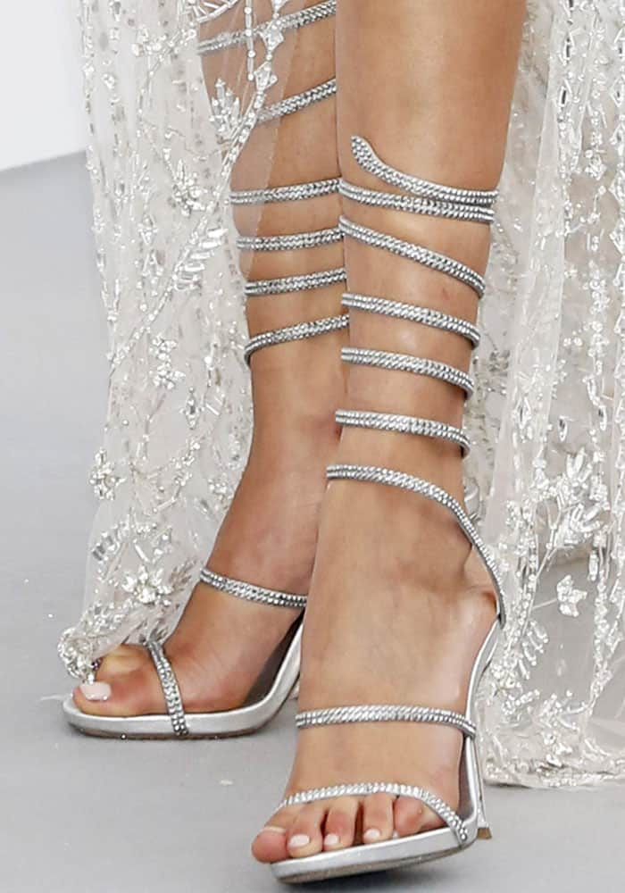 Bella echoes the diamonds on her dress by wearing a pair of sparkly René Caovilla wrap sandals