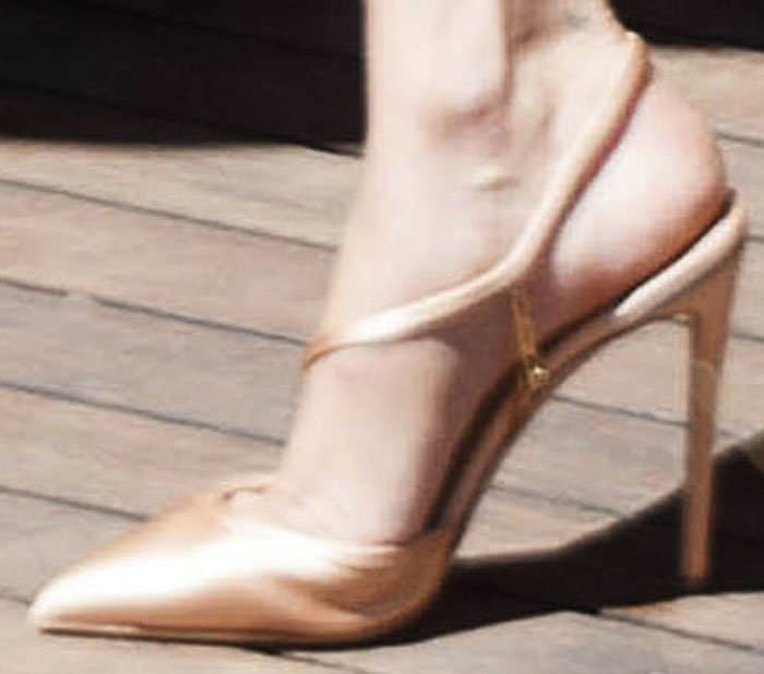 """Bella steps out of her hotel in satin Olgana Paris """"La Troublante"""" pumps"""