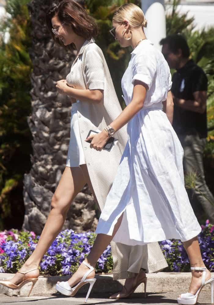 Bella is accompanied by her friend and fellow model, Hailey Baldwin